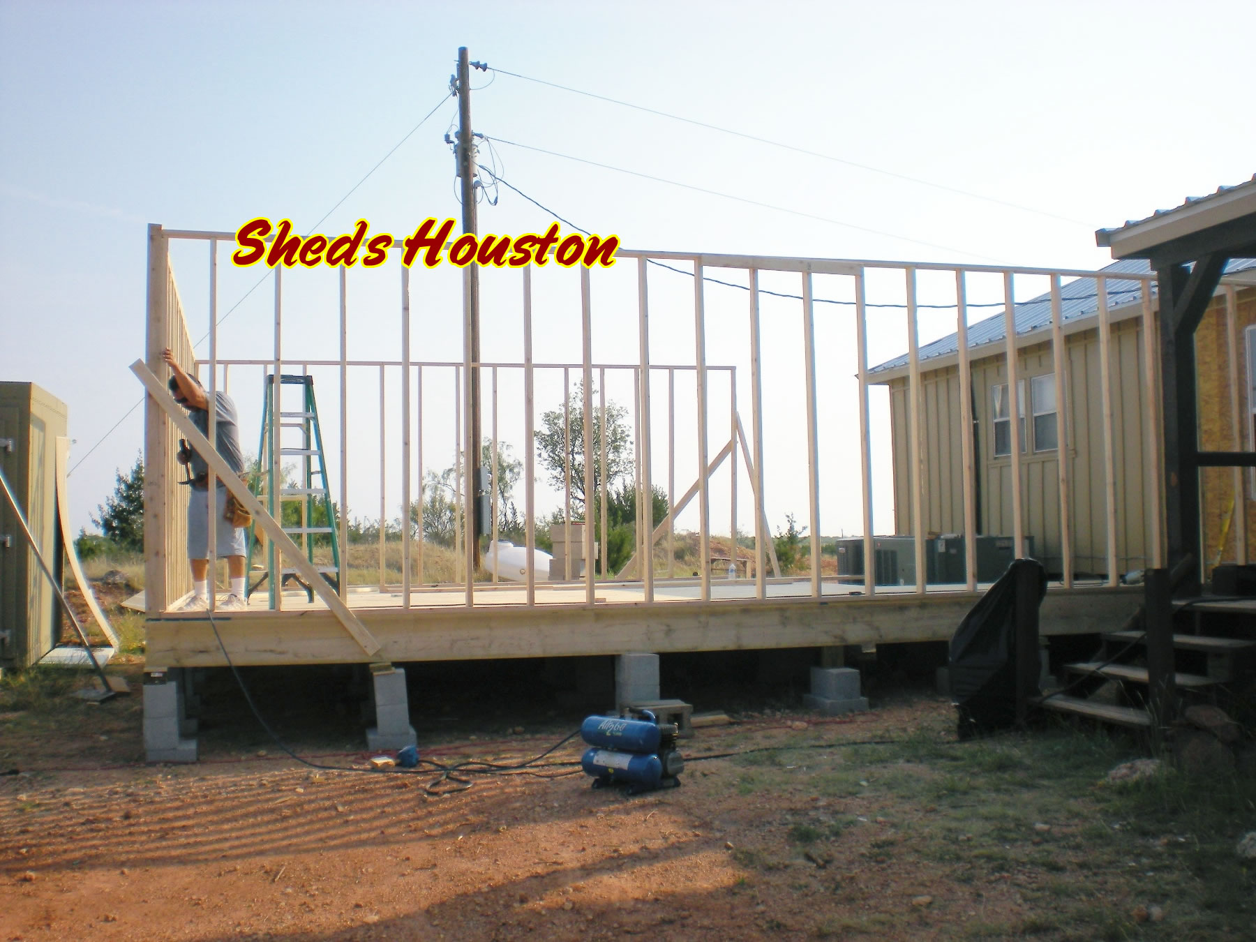 Photos sheds patios roofing repair barns humble tx for Raised floor house